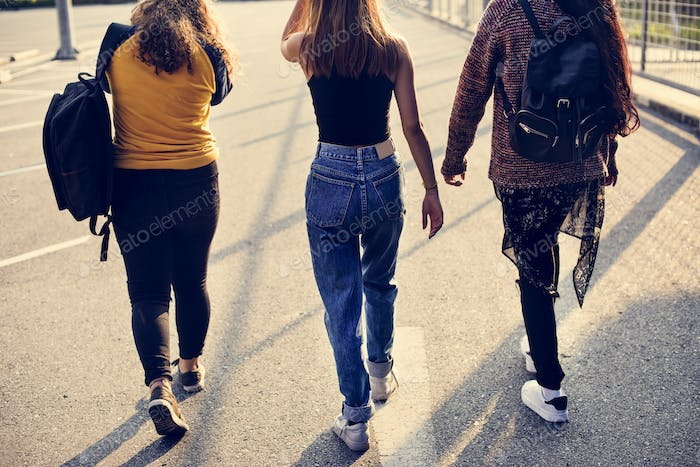 Teenage girl friends walking together