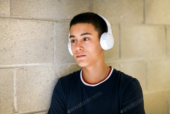 Young man standing relaxing listening to music