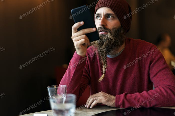 Bearded hipster sending a voice message