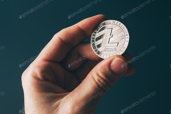 Litecoin cryptocurrency in hand