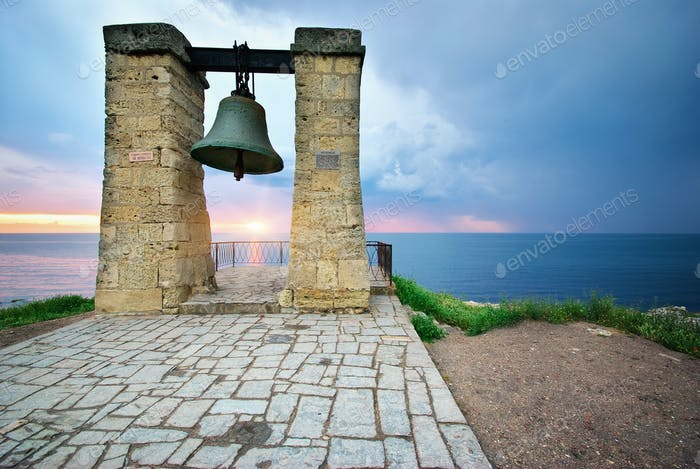 Big bell on sea shore
