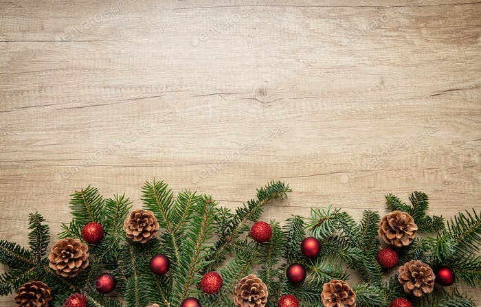 Fir twig fresh border against wooden background