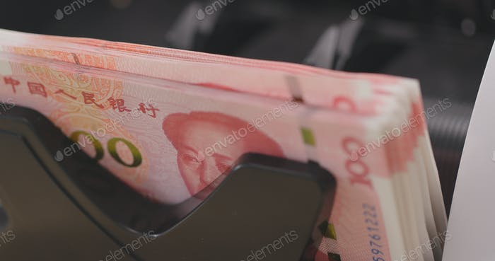 Cash money counting machine checking number of Chinese banknote
