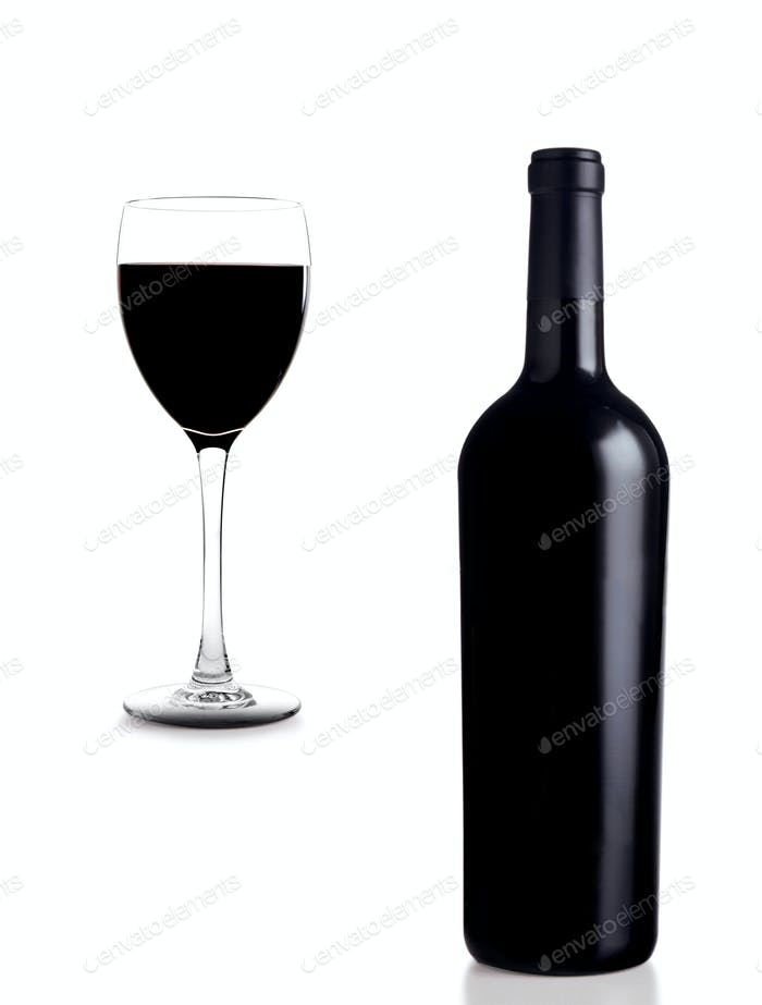 Glass and wine with bottle