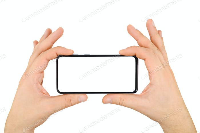 Two hands holding cellphone with empty screen isolated