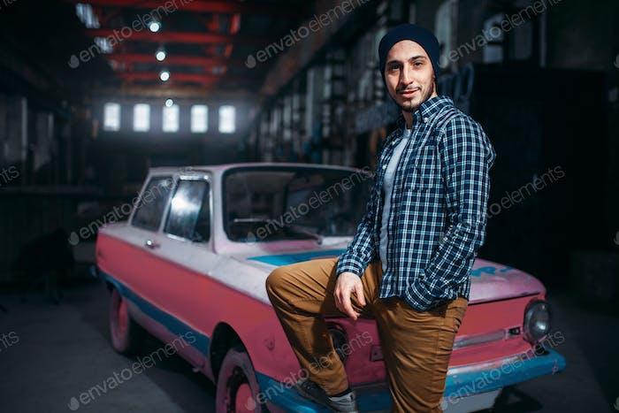 Stalker, traveler pose against USSR retro car