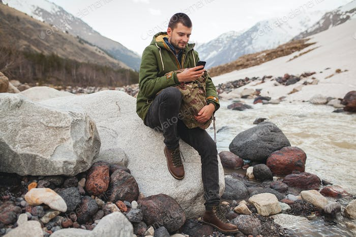 young hipster man hiking, traveling, backpacker