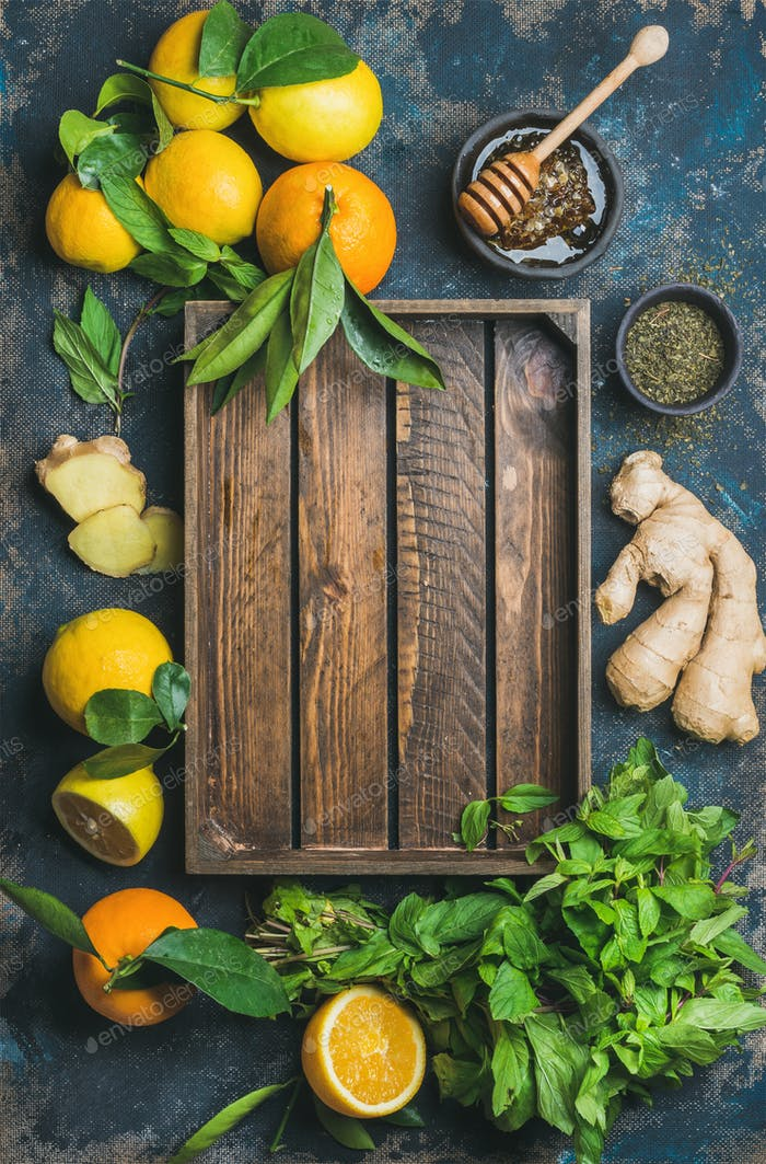 Ingredients for making natural drink with wooden tray in center