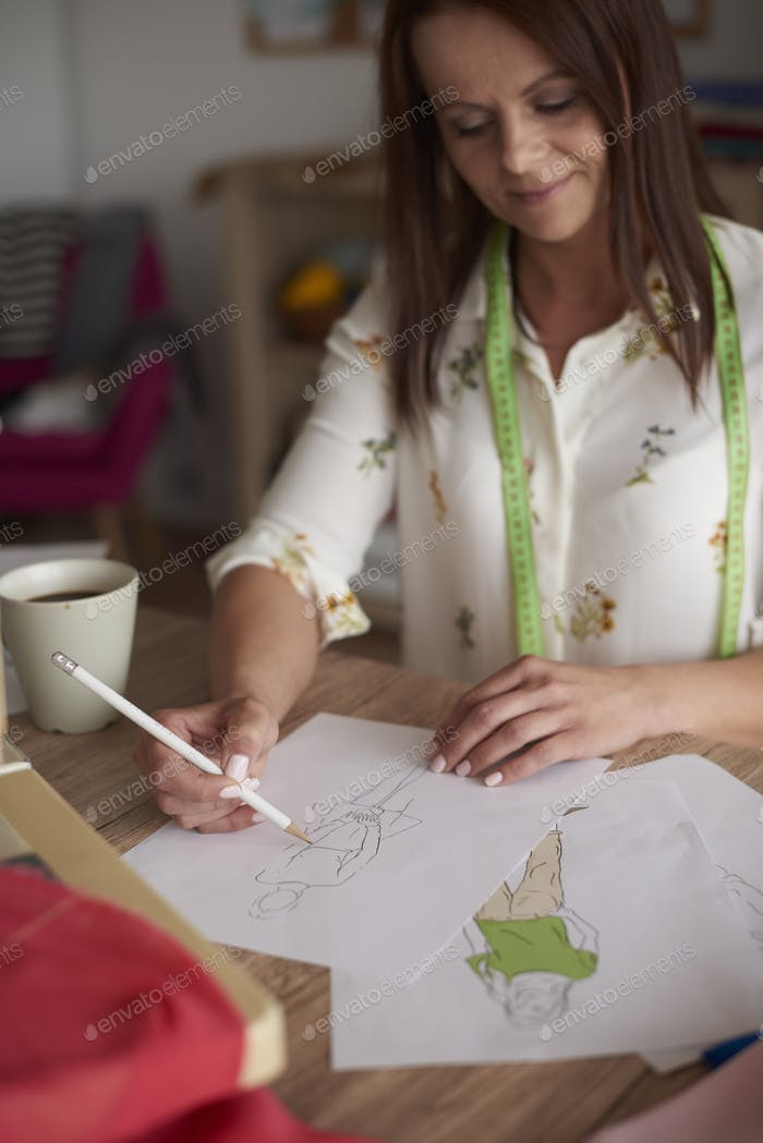 Woman making drawings of her projects