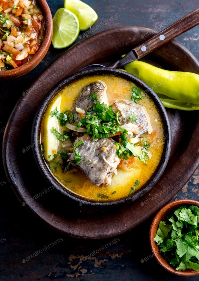 Thumbnail for Chilean Food. Fish Soup Caldillo de Congrio Served in Clay Bowl, Top View.