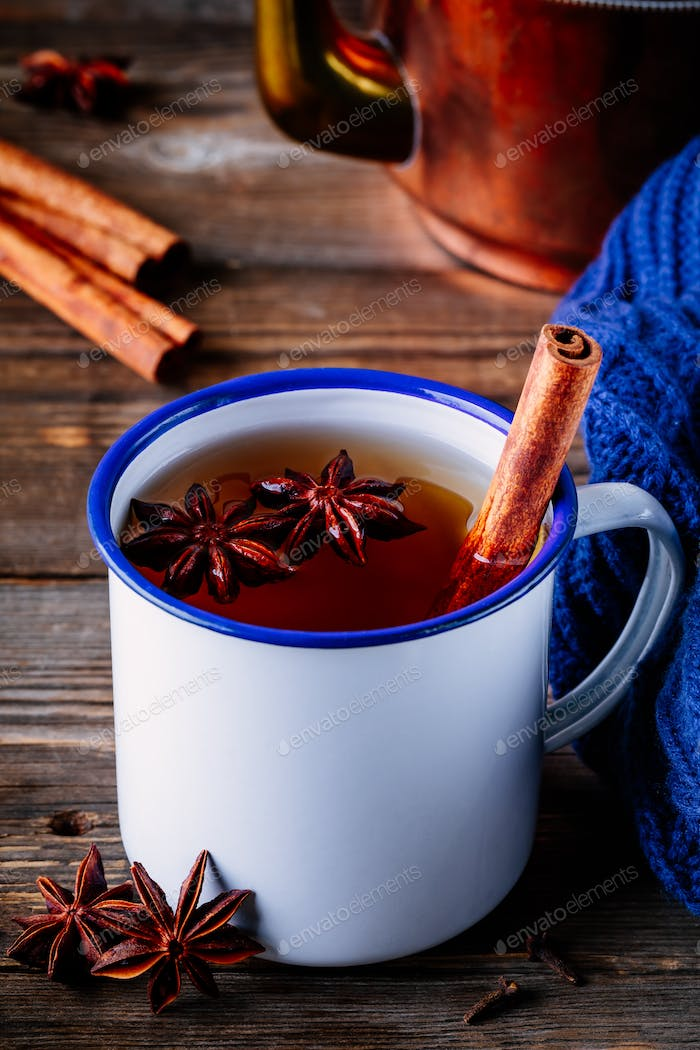 Autumn hot tea with spices cinnamon and anise in mug