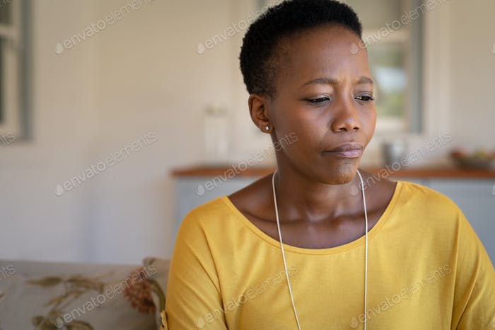Sad mature black woman alone