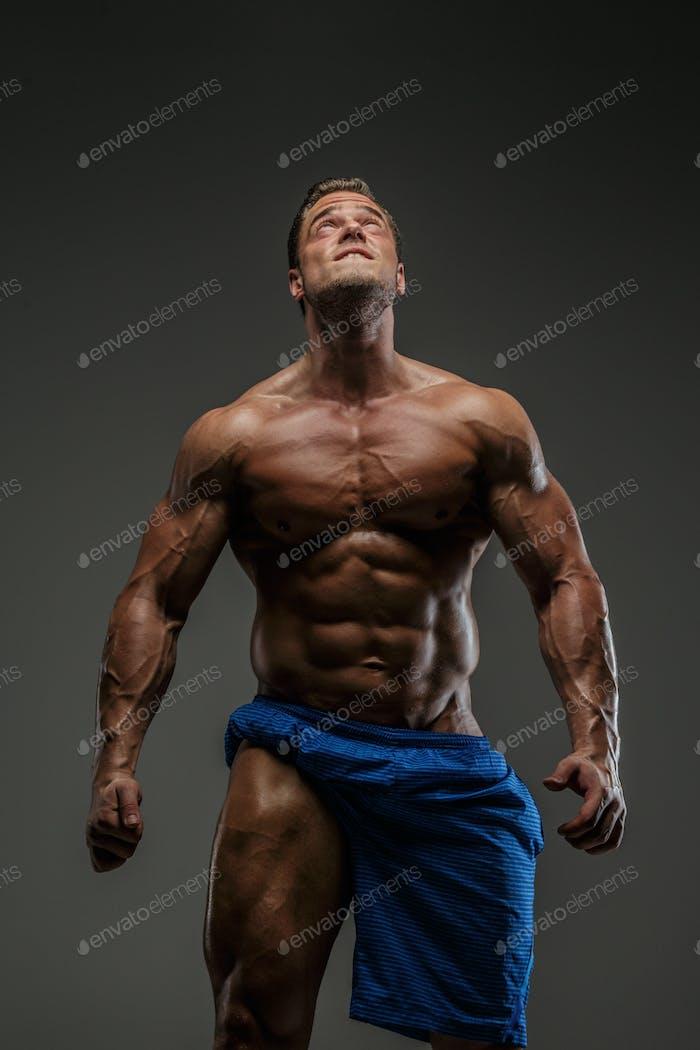 Muscular guy posing in studio