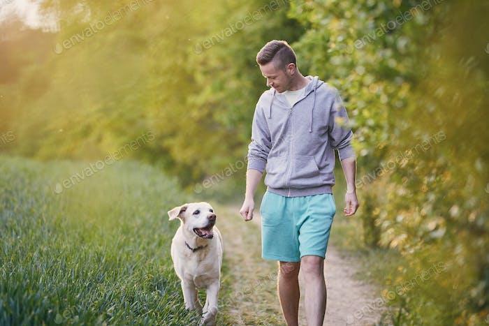Man with dog on footpath