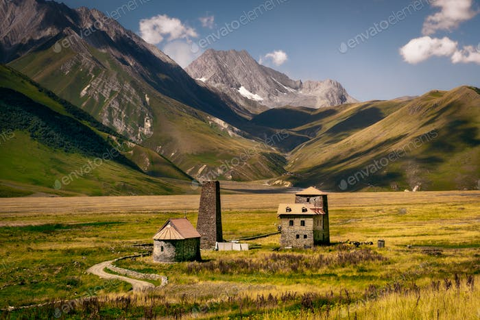 Landscape view of Caucasus mountains and stone houses and tower, Country of Georgia