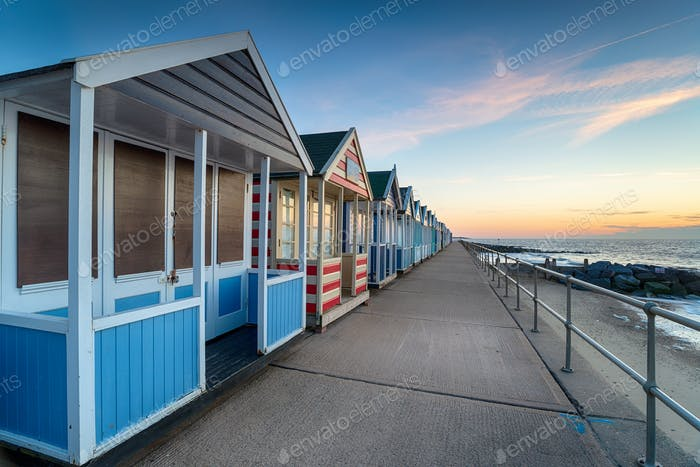 Pretty beach huts on the promenade at Southwold