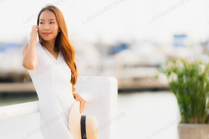 Portrait beautiful young asian woman leisure smile happy relax a