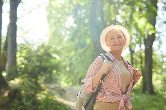 Mature woman in the forest