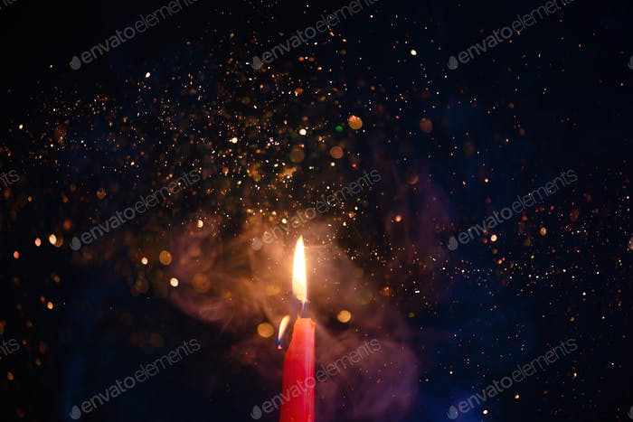 Flame and smoke texture with sparkles. Candle fire on a black background with gradient blue and