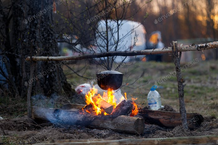 Campfire with a cooking pot