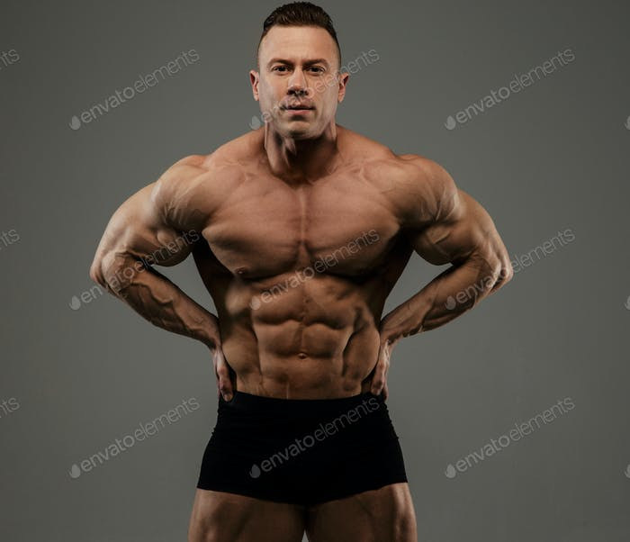 Big bodybuilder in black panties