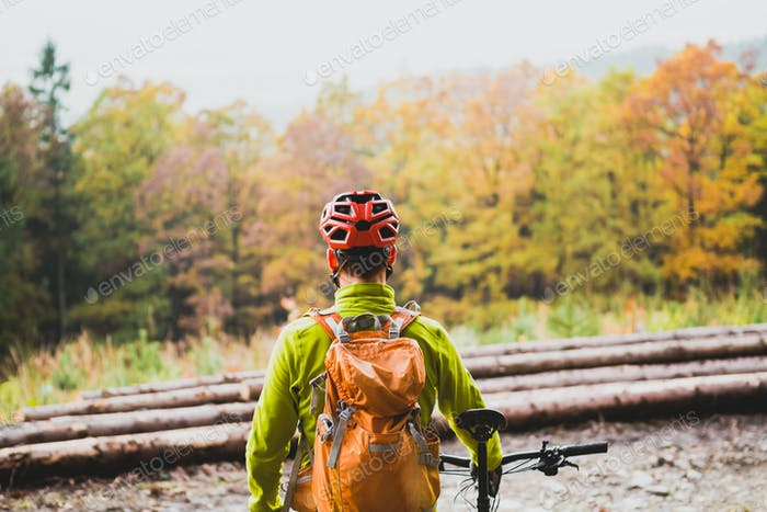 Mountain biker looking at inspiring forest landscape