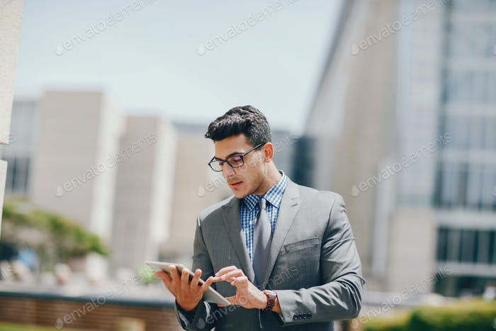 businessman in a summer city