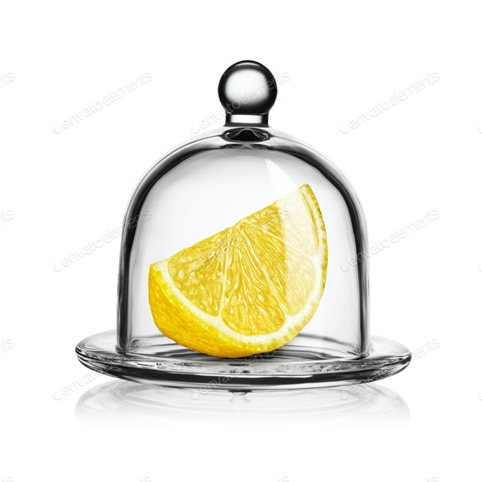 Slice of yellow lemon in glass bell jar isolated on white.