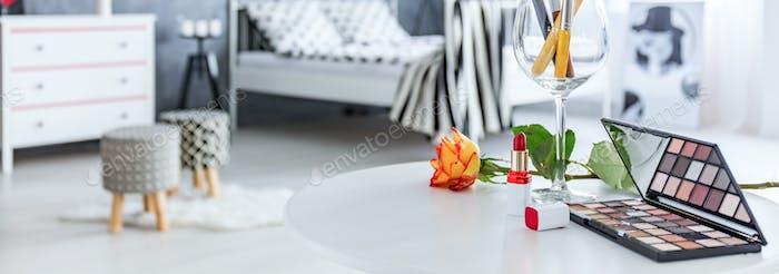Cosmetics lie on table