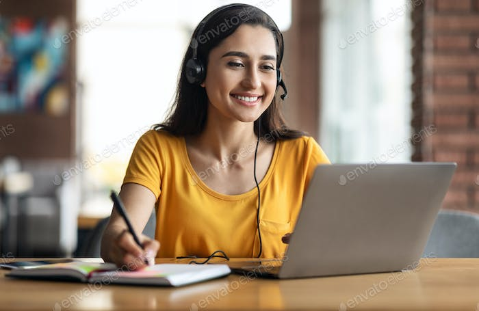Happy young arab woman having educational course online