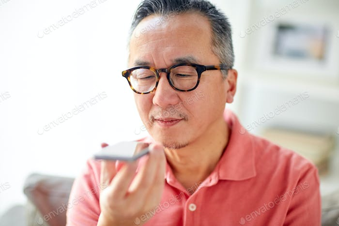 man using voice command recorder on smartphone