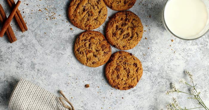Cookies on table with glass of milk