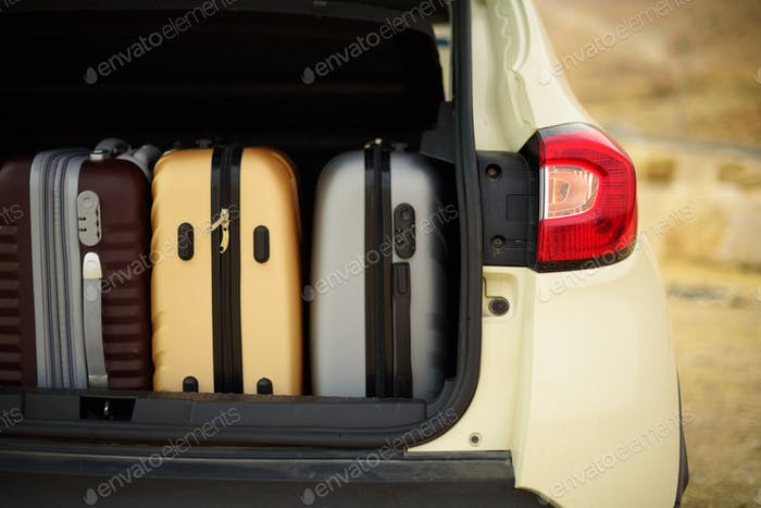 Opened car trunk full of suitcases, luggage, baggage. Summer holidays, travel, trip, adventure