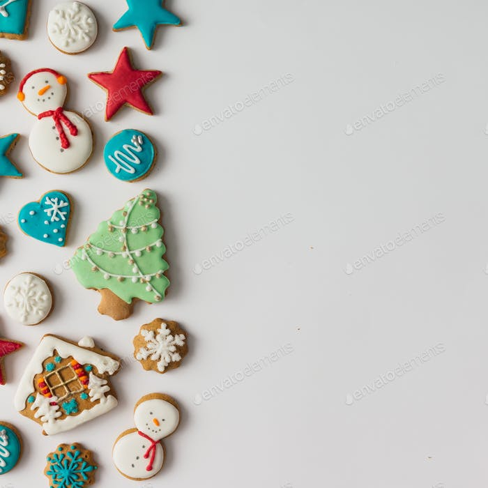 Colorful pattern made of Christmas cookies and red berries. Flat lay holiday concept.