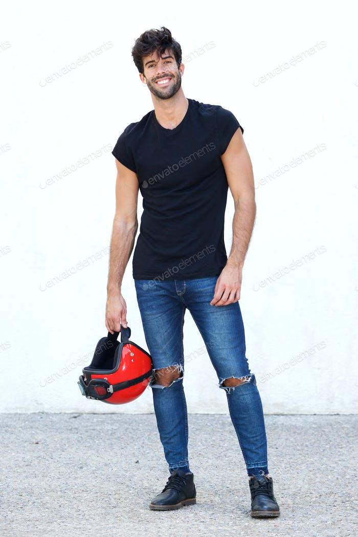 Full body motorcyclist with helmet and ripped jeans