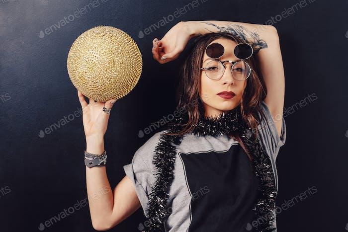 Portrait of seductive hipster girl wearing glasses