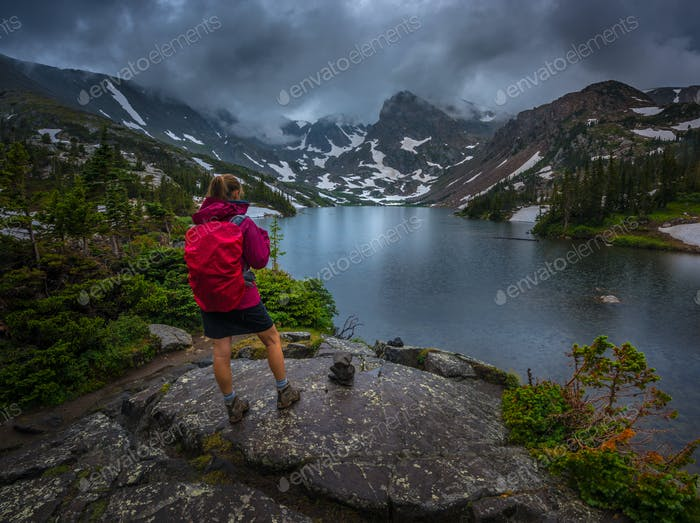 Hiker looks at Lake Isabelle Brainard Lake Recreation Area