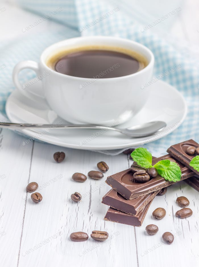 Dark delicious chocolate with a cup of coffee