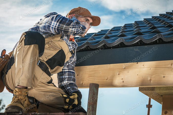 Roof Contractor Talking On Cell Phone.