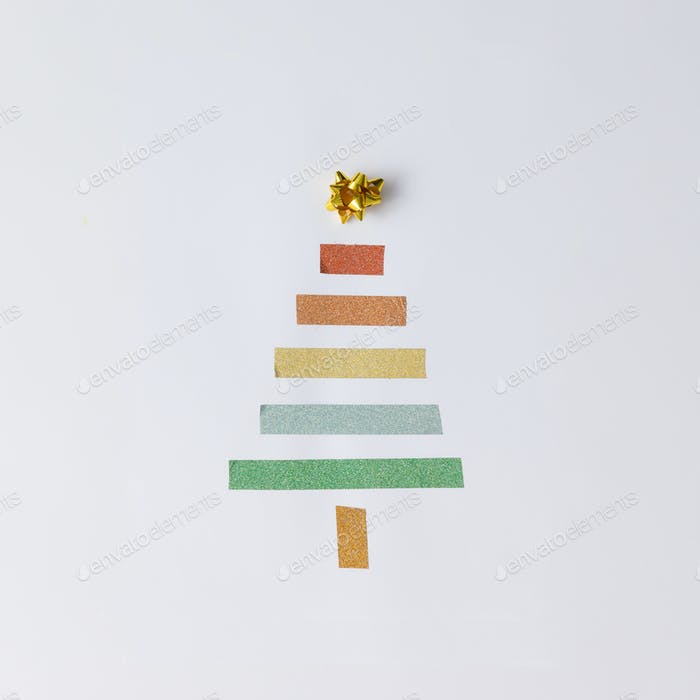 Minimalistic Christmas tree made of tape on white background.