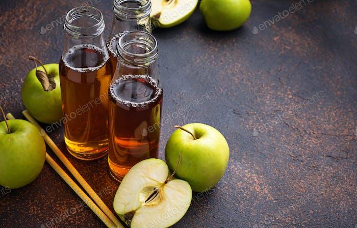 Bottles with fresh apple juice