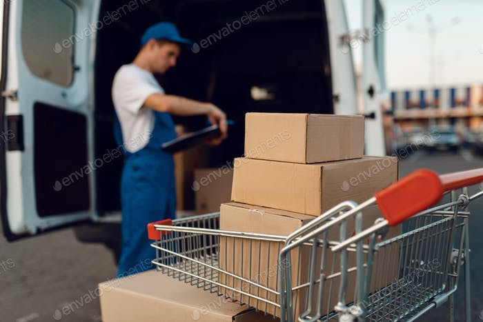 Parcel boxes in cargo cart, delivery service