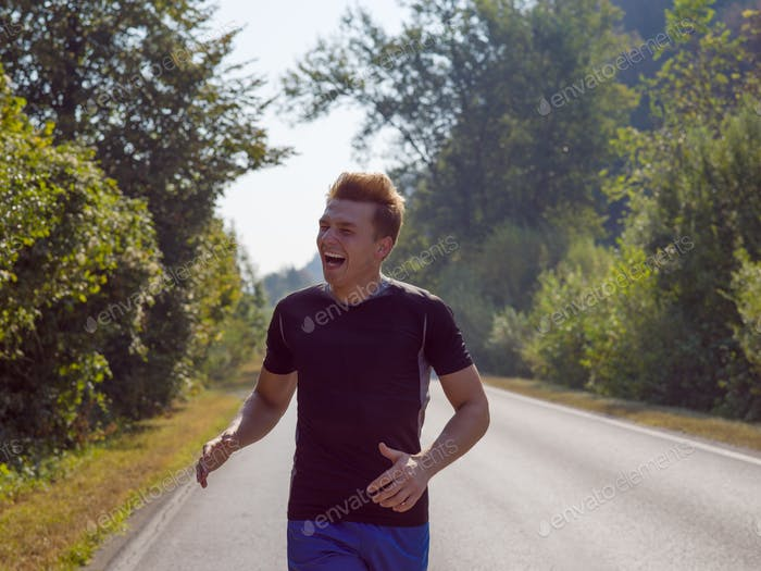 man jogging along a country road