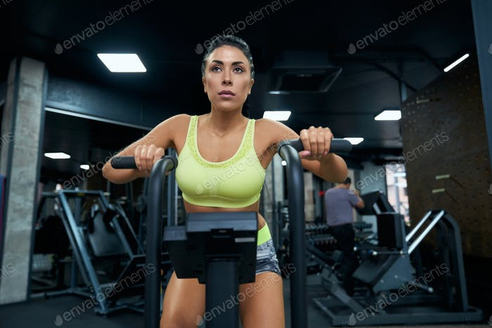 Fit woman doing cardio in gym
