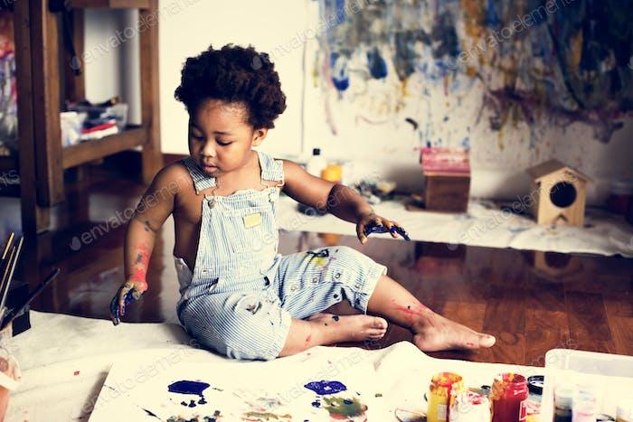 Thumbnail for Black kid enjoying his painting