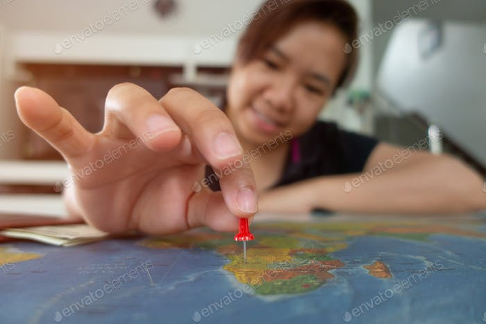 asian woman pinned on the map location