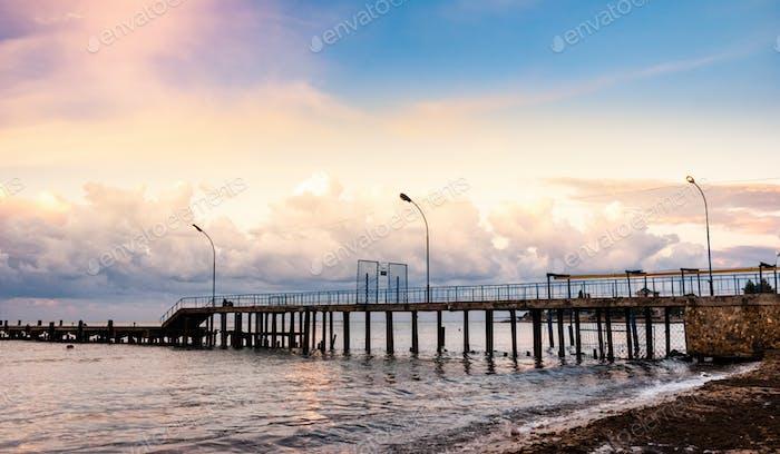 Metal bridge in the open sea with blue sky