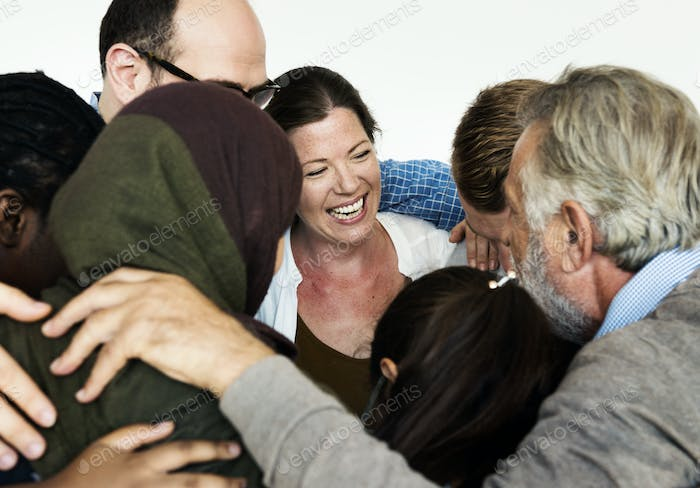 Group of diverse people arms around others