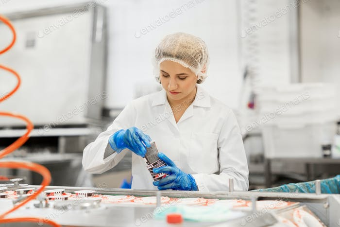 woman working at ice cream factory conveyor