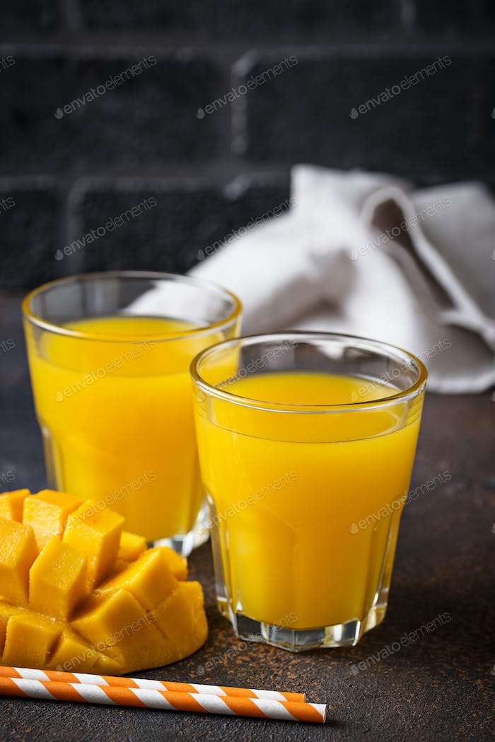 Fresh mango juice on dark background